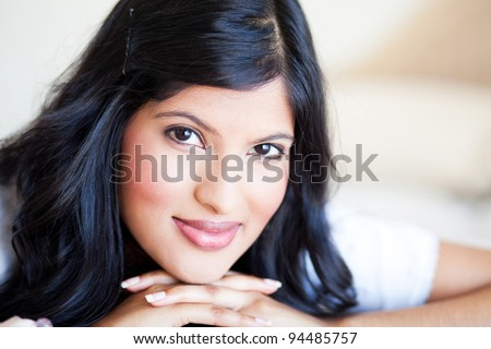 beautiful young woman closeup portrait on bed