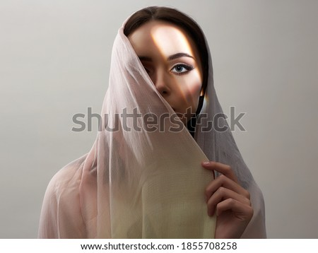 beautiful young woman covered her face. beauty woman in sunlight. fashion oriental style woman. ethnic people Stockfoto ©