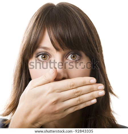 Beautiful young woman covering the face with her hand, isolated on a white background