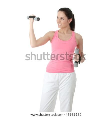 Beautiful young woman doing exercise with dumb bells , isolated