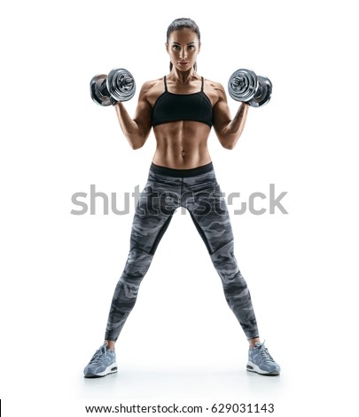 Beautiful young woman doing exercises with dumbbells at biceps. Photo athletic woman with perfect body isolated on white background. Strength and motivation