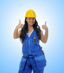 Beautiful young woman doing repairs on blue background
