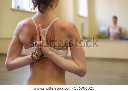 Beautiful young woman doing yoga exercise - Meditating