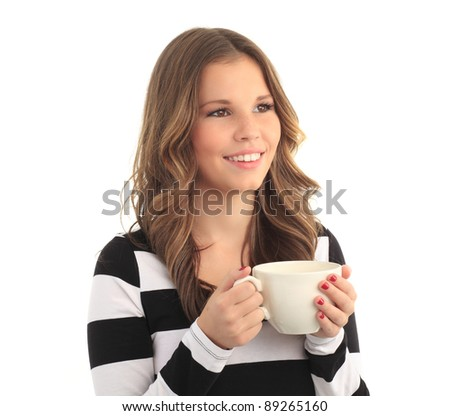 Beautiful young woman drinking a cup of coffee against white background