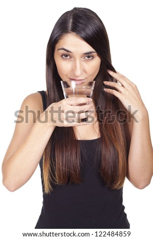 beautiful young woman drinking a glass of water