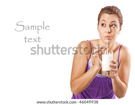 Beautiful young woman drinking a healthy glass of milk - on white background with space for text