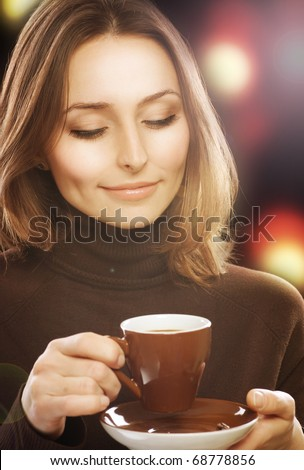 Beautiful Young Woman drinking Coffee