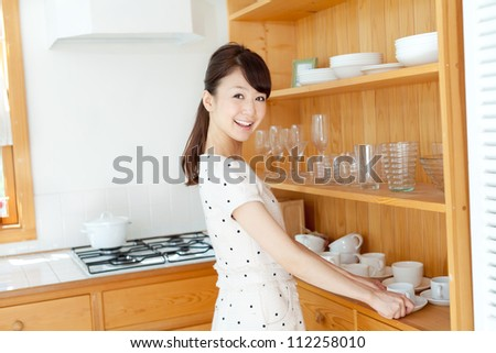 Beautiful young woman drinking coffee. Portrait of asian.