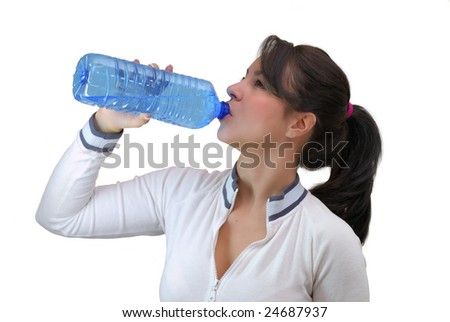beautiful young woman drinking water from a bottle isolated on white background