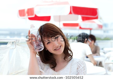 Beautiful young woman drinking water. Portrait of asian woman.