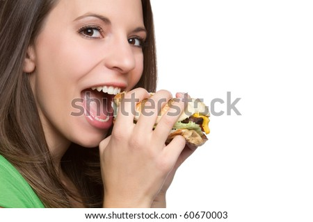 Beautiful young woman eating hamburger