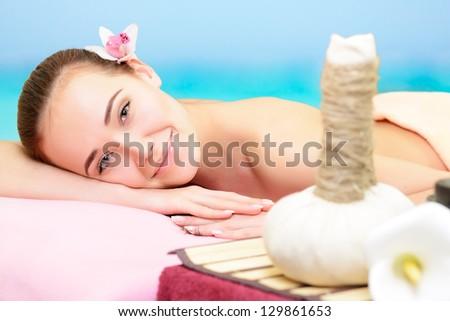 Beautiful young woman enjoy in spa salon, caucasian beauty model