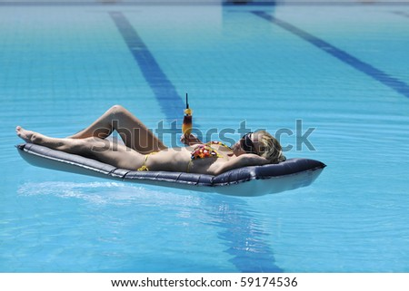 beautiful young woman enjoy sun and coctail dring relaxing and have fun at siwmming pool