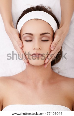 Beautiful young woman enjoying a facial massage