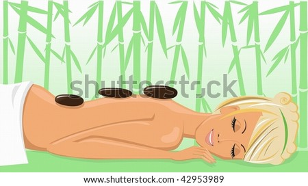 Beautiful young woman enjoying a massage in the spa