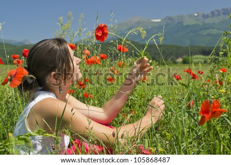 Beautiful young woman enjoying a perfect sunny day in the countryside