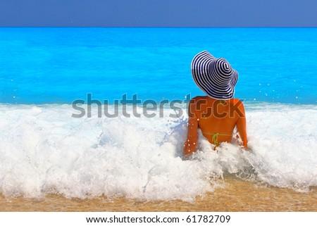 Beautiful young woman enjoying the Ionian sea in Greece