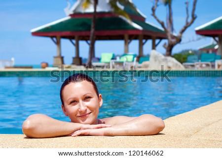 Beautiful young woman enjoying tropical holidays