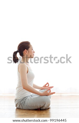 beautiful young woman exercising - stock photo