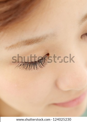 Beautiful young woman eyelash extension