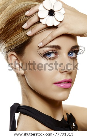 beautiful young woman face close-up wearing bright pink lipstick and long false eyelashes with glitter and a large flower cocktail ring.