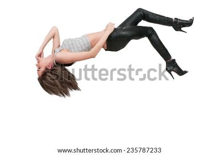 Beautiful young woman falling through the sky #235787233