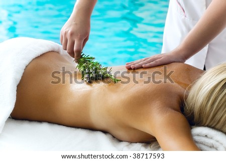 Beautiful young woman getting a spa treatment - stock photo