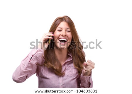 Beautiful young woman getting good news on her cellphone