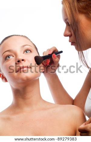 beautiful young woman getting nature make-up