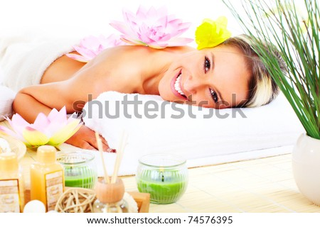 Beautiful young woman getting spa massage. Relax. - stock photo