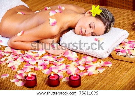 Beautiful young woman getting spa massage. Relax.