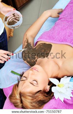 Beautiful young woman getting spa treatment at a salon. Beauty, healthcare.