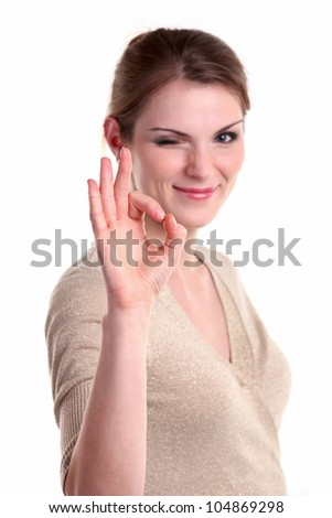 Beautiful young woman giving the ok sign and winking, isolated over white