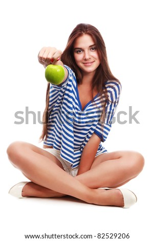 beautiful young  woman  giving us a green apple