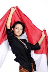 Beautiful Young Woman hanging indonesian flag using hand in her head. Pretty woman wearing kebaya