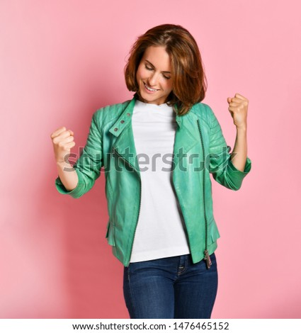 Beautiful young woman happy and excited expressing winning gesture. Successful and celebrating victory, triumphant, pink background #1476465152