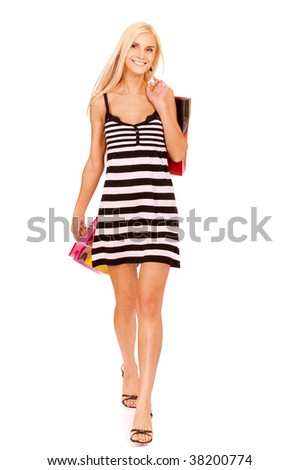 Beautiful young woman has made shopping and comes back home with purchases, it is isolated on white background.