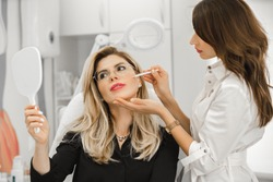 Beautiful young woman having aesthetic treatment in medical office, Corrective medicine concept. Doctor beautician.