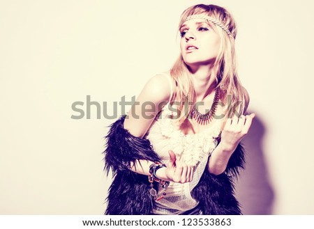 Beautiful young woman hippie on white background