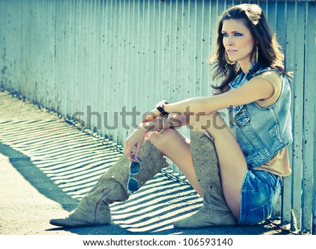 Beautiful young woman hippie posing outdoor