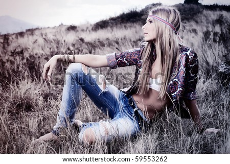Beautiful young woman hippie posing over picturesque landscape. - stock photo