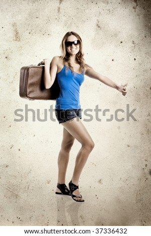 Beautiful young woman hitch hiking with old leather suitcase - grunge background aded in PS
