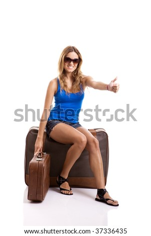 Beautiful young woman hitch hiking with old leather suitcases - isolated on white