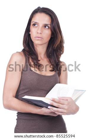beautiful young woman holding a book and thinking