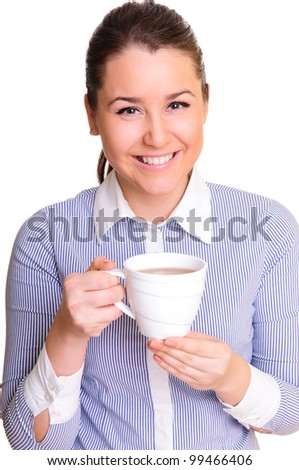 beautiful young woman holding a cup of tea in hand. positive smile. isolated on white.