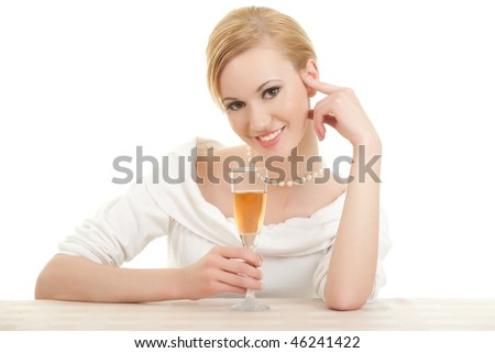 Beautiful young woman holding a glass of wine