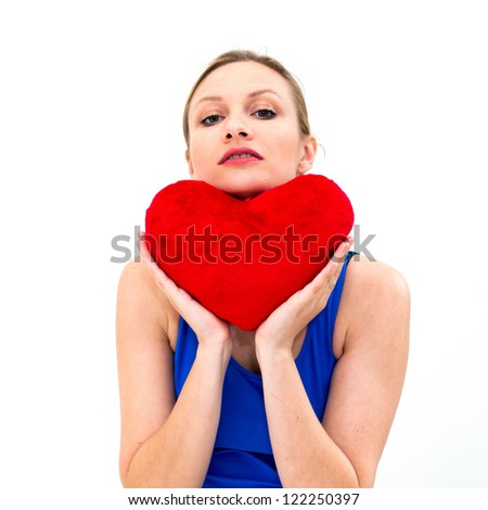 beautiful young woman holding a red heart - stock photo