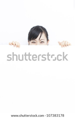 beautiful young woman holding blank billboard