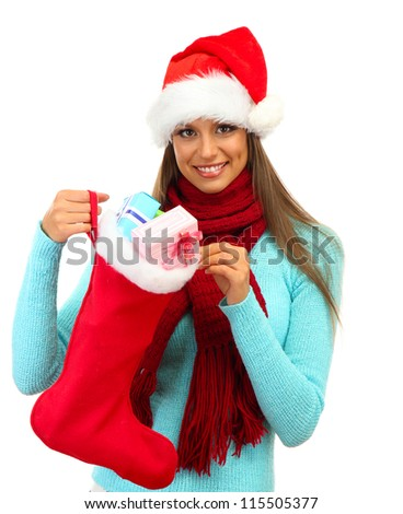 beautiful young woman holding  christmas sock with gifts, isolated on white - stock photo