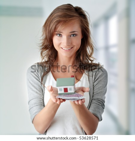 Beautiful young woman holding euros bills and house model over white real estate loan concept